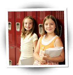 Two girls leaning against lockers